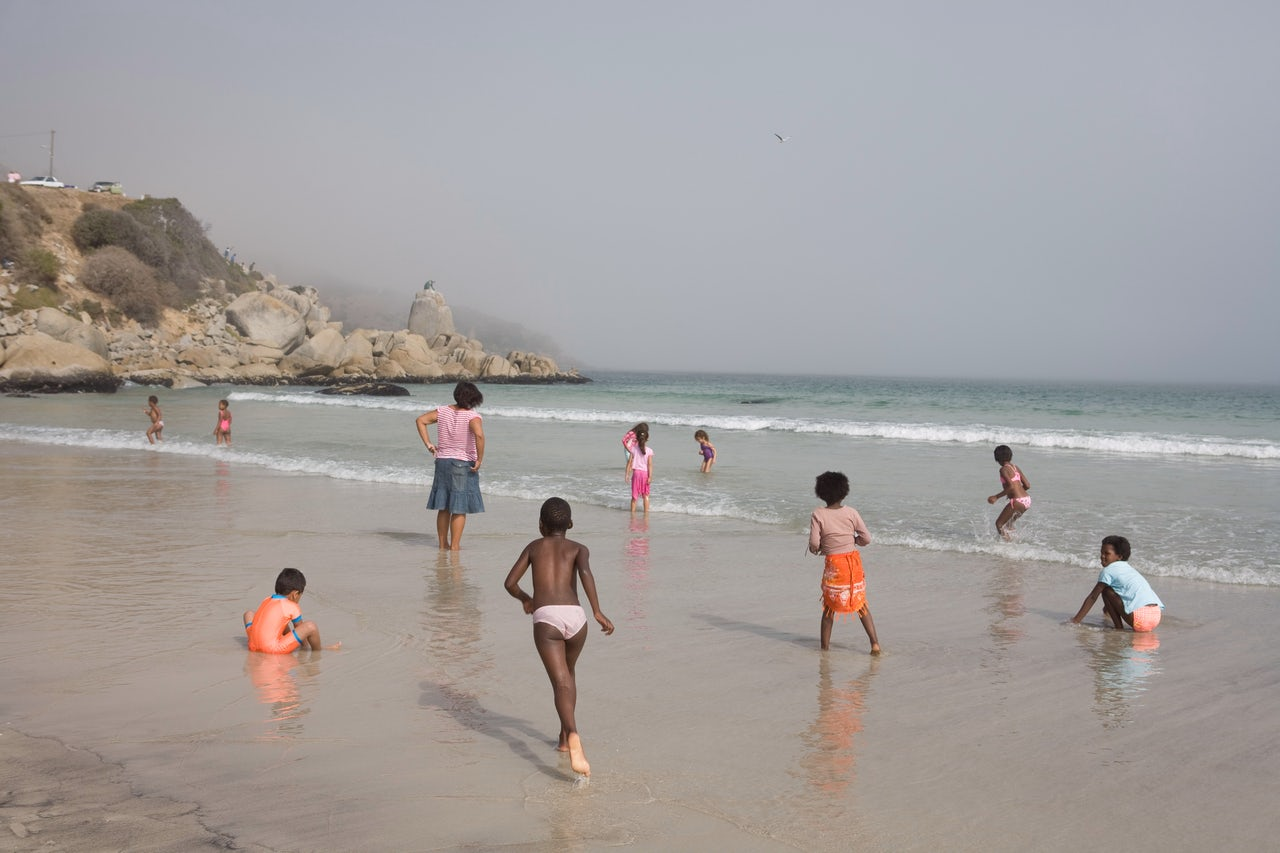 Children play on a Cape Town beach that was once whites-only.