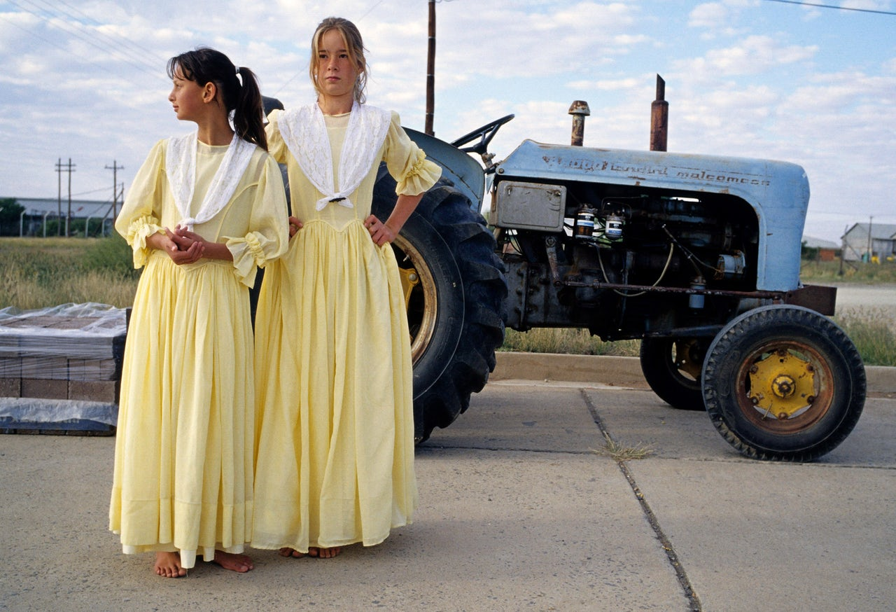 Afrikaner girls dressed up in traditional clothing in Orania, a whites-only town in South Africa.