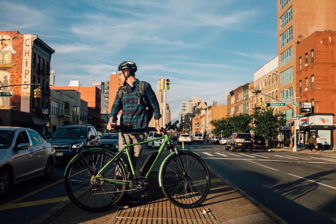 Aaron Gordon with an e-bike in Brooklyn.