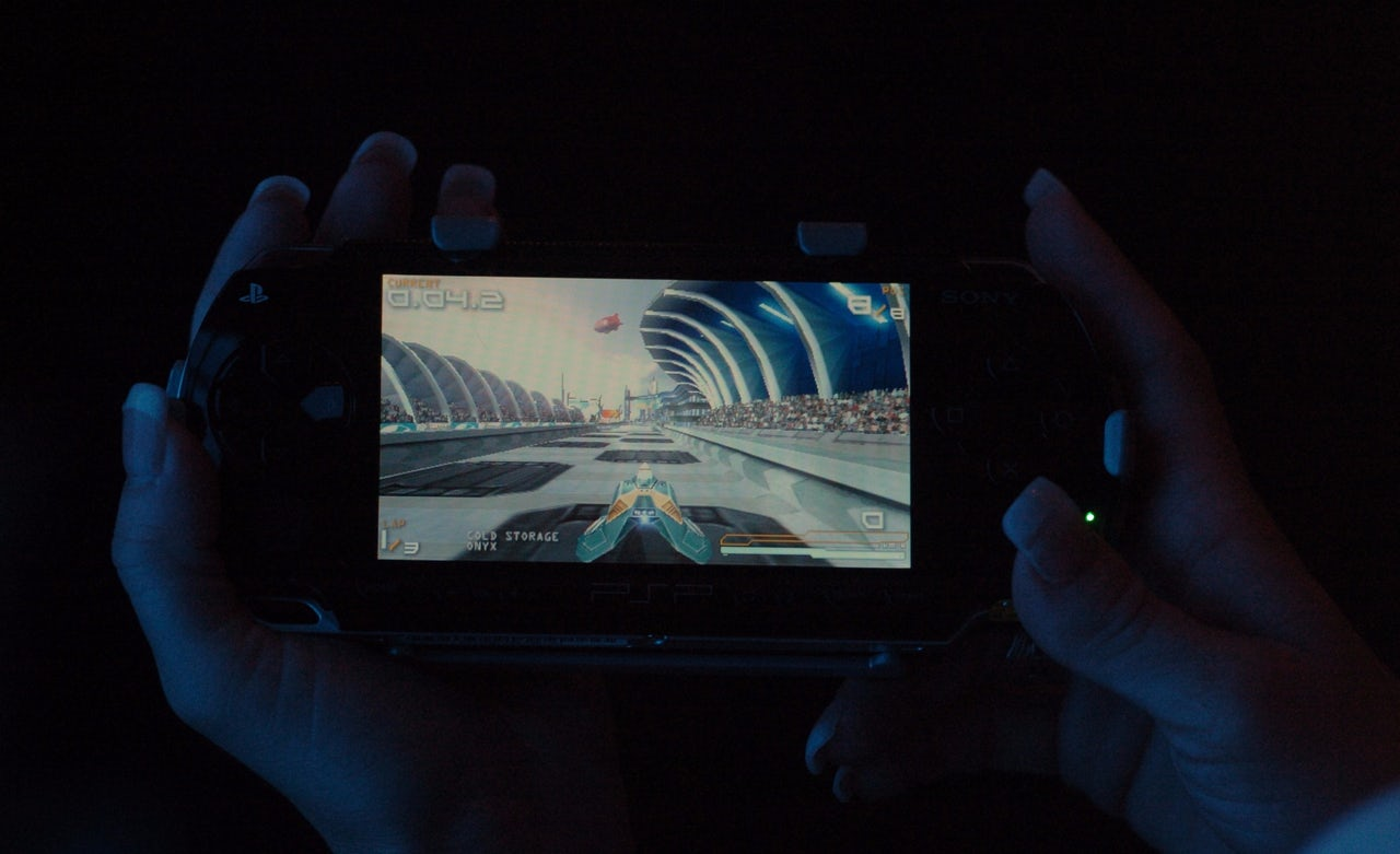 A shot of a racing game on the Sony PSP after its release in 2005. The screen was large, but the graphics in the games were more detailed and the perspective was zoomed out, making it harder for some vision-impaired players to see.