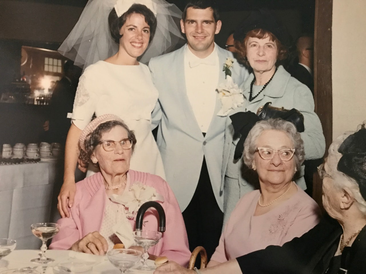 Inez Burns (standing, on the right) at a family wedding in 1965.
