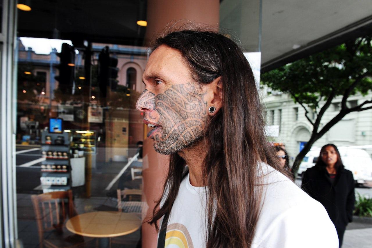 A Maori with tā moko facial tattoos