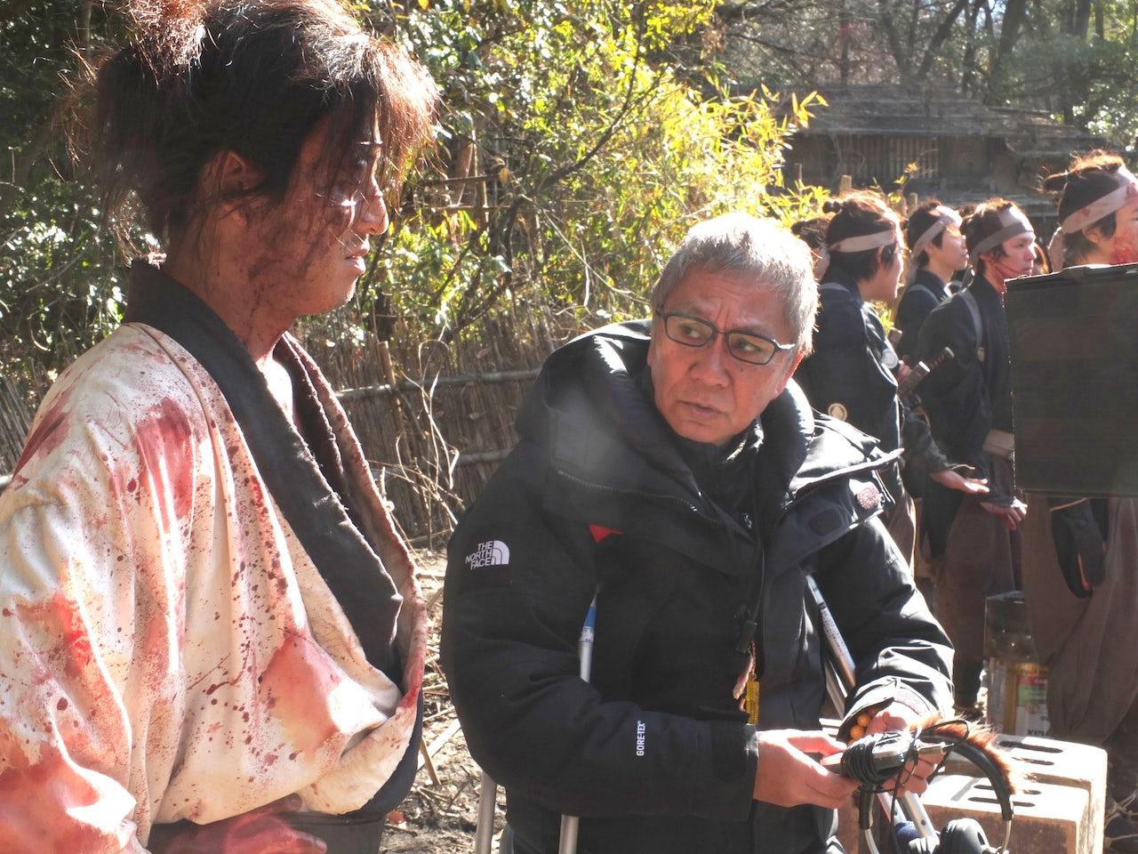 Takashi Miike speaks with lead actor Takuya Kimura (Manji) on the set of Blade of the Immortal.