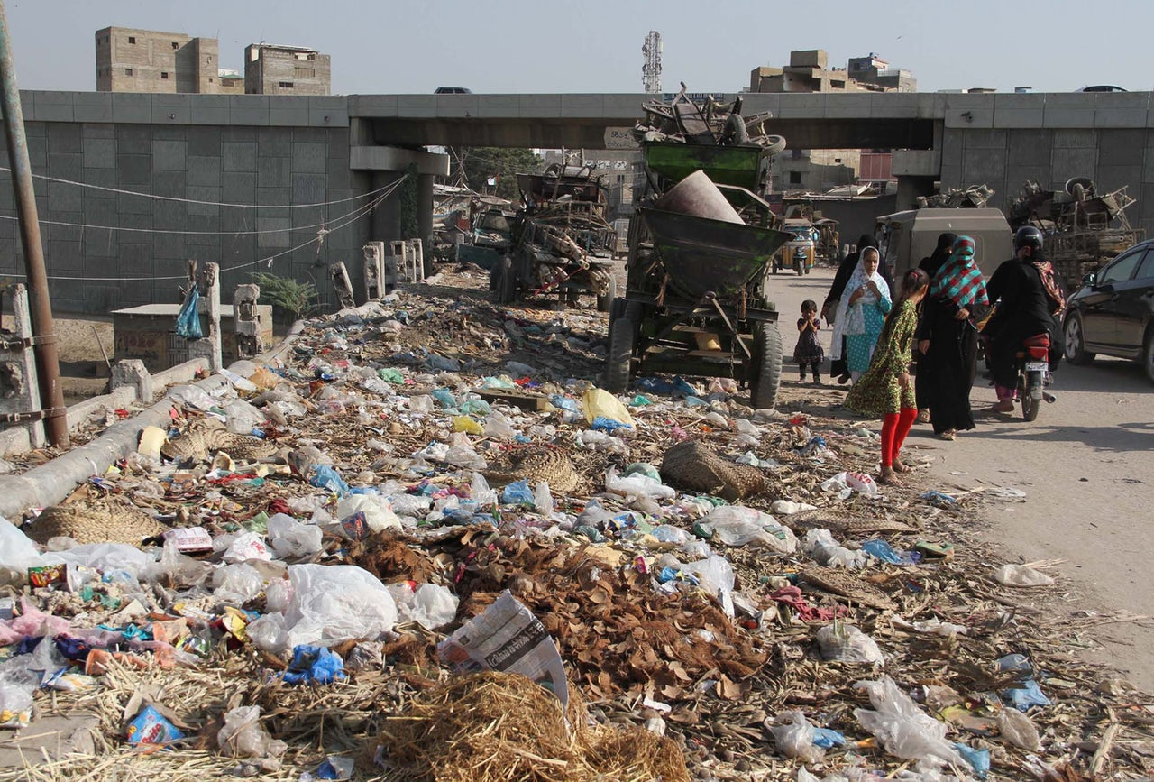 Excess trash spills over onto a roadway in Karachi.
