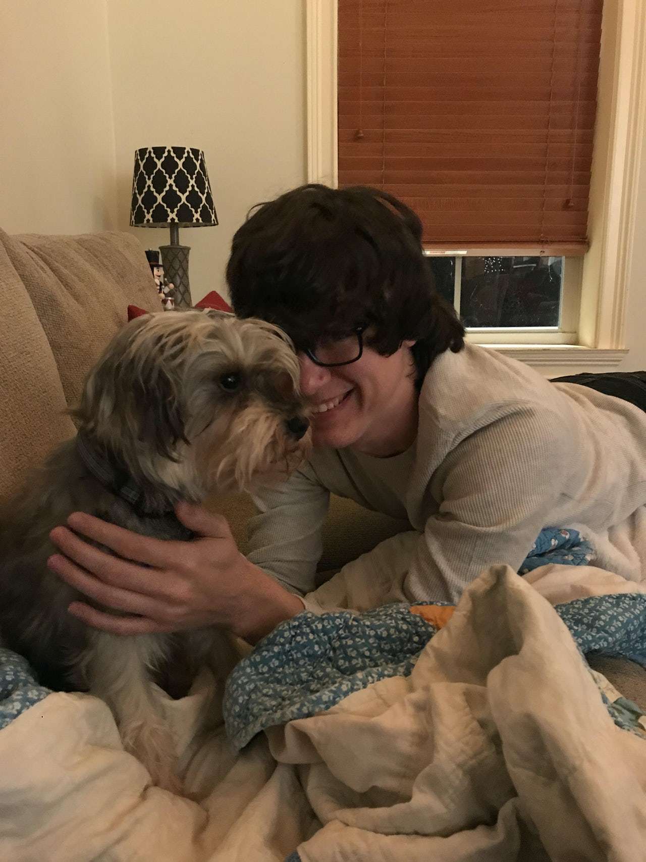 Josh and his family's dog, Andy, after his release from prison and before his stay in rehab.