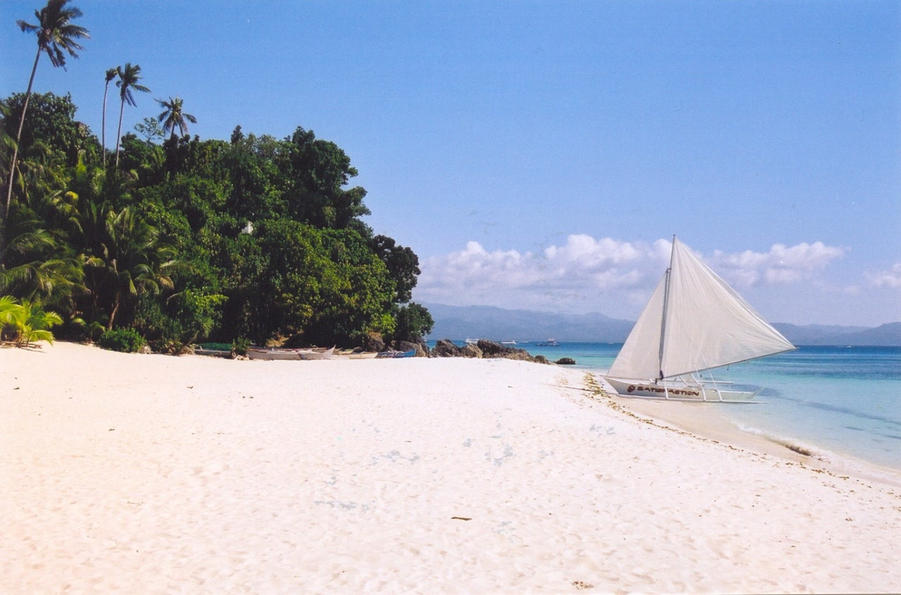 Boracay Island in the Philippines, which was recently closed due to the effects of climate change.