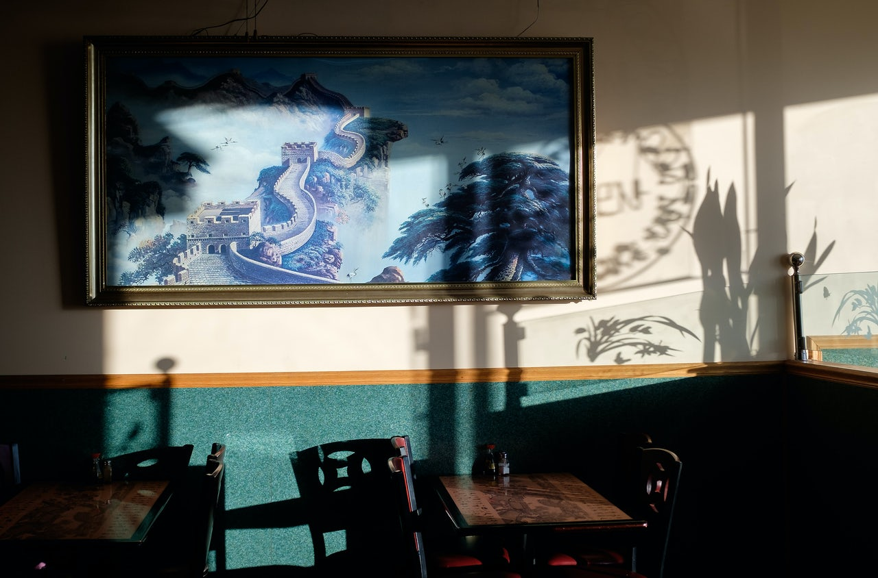 The sun falls in the empty dining area of a Chinese restaurant in central Pennsylvania. The town is home to around 2,500 people and this is one of the main restaurants.
