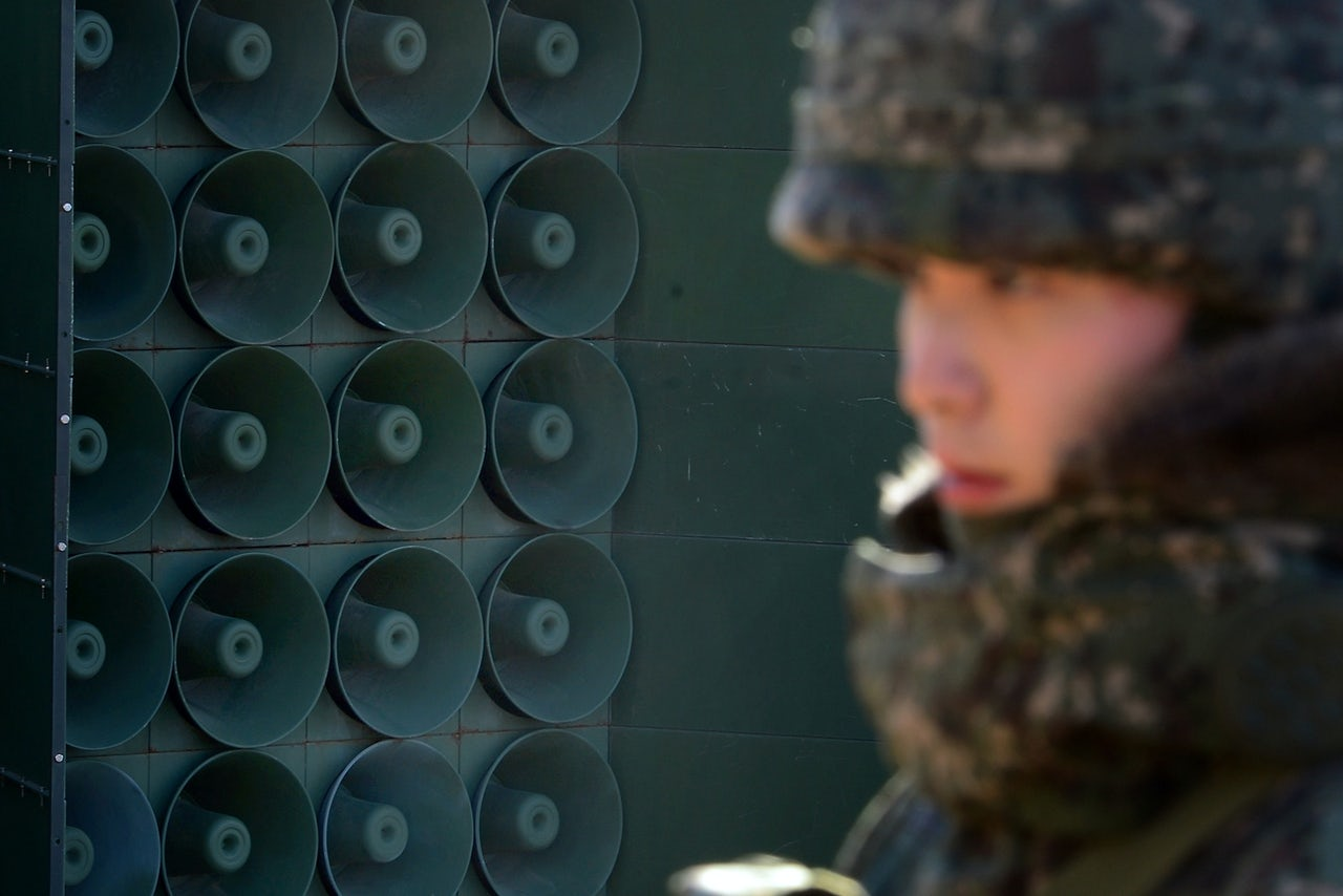 A South Korean solider stands next to the speakers at the DMZ.