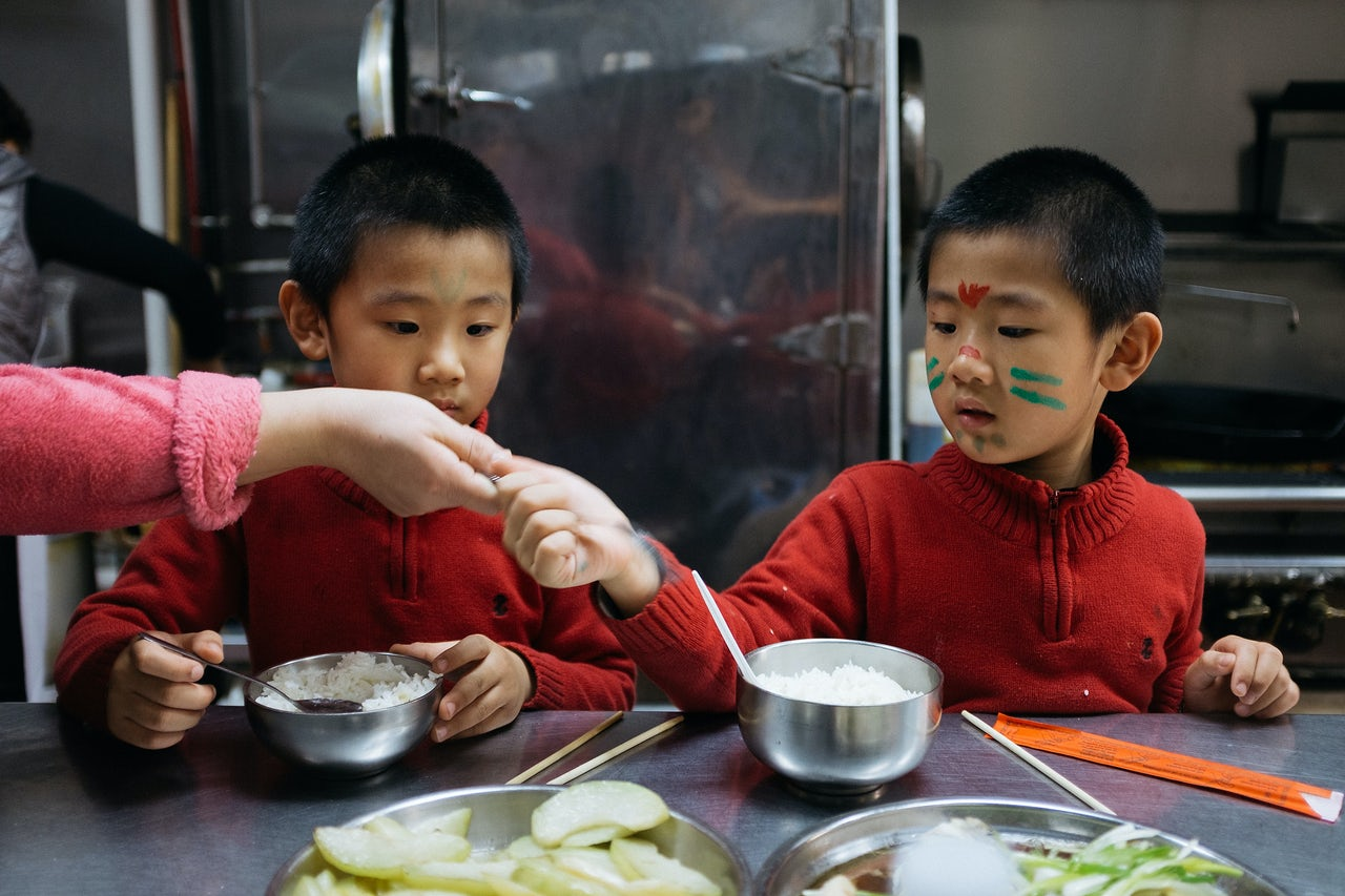 Instead of eating the food they serve to customers, the mother prepares vegetables and fish for her kids to eat.