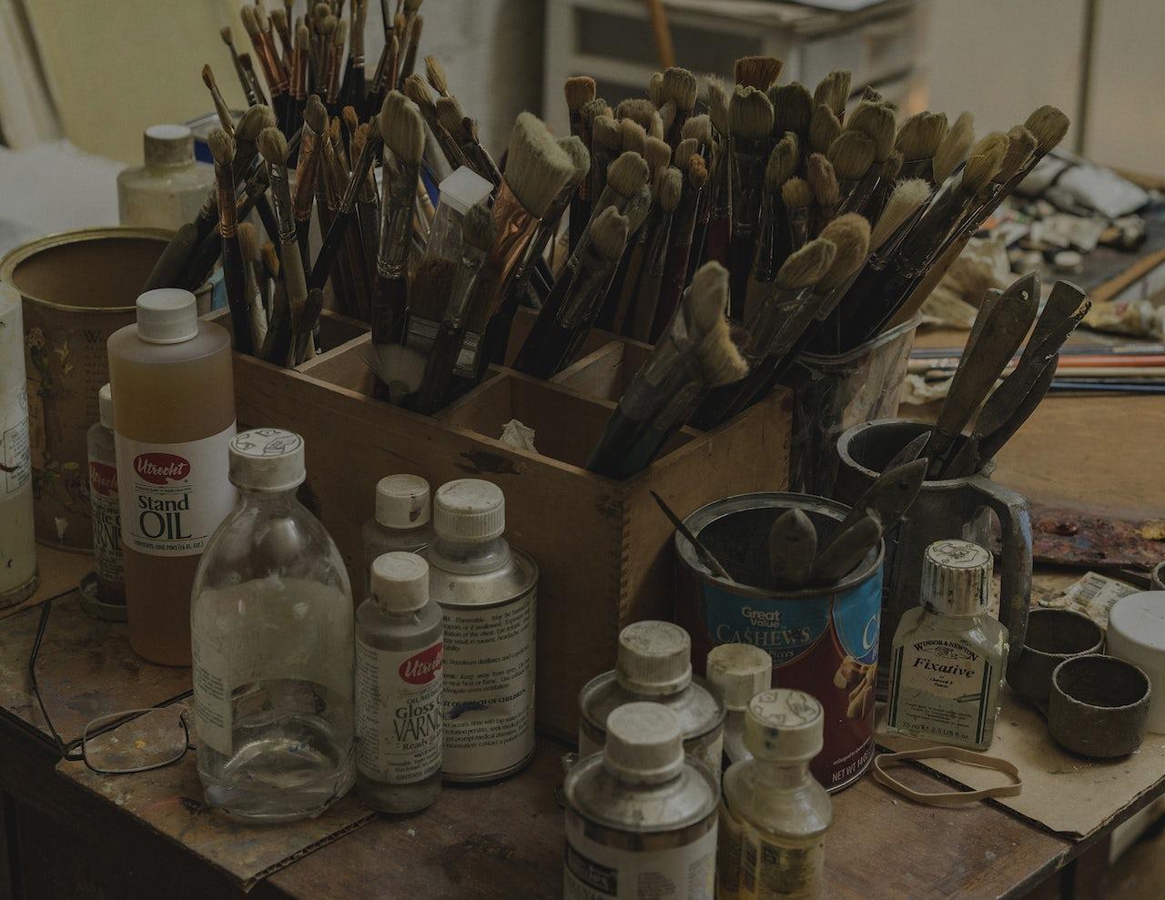 Paintbrushes in Burton Silverman's studio.