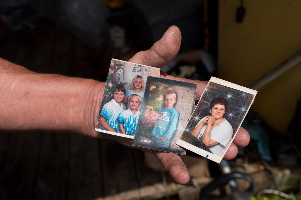 Leonard Manley's wallet is filled with pictures of his daughter and grandchildren, who were murdered in April 2017. The case remains unsolved.
