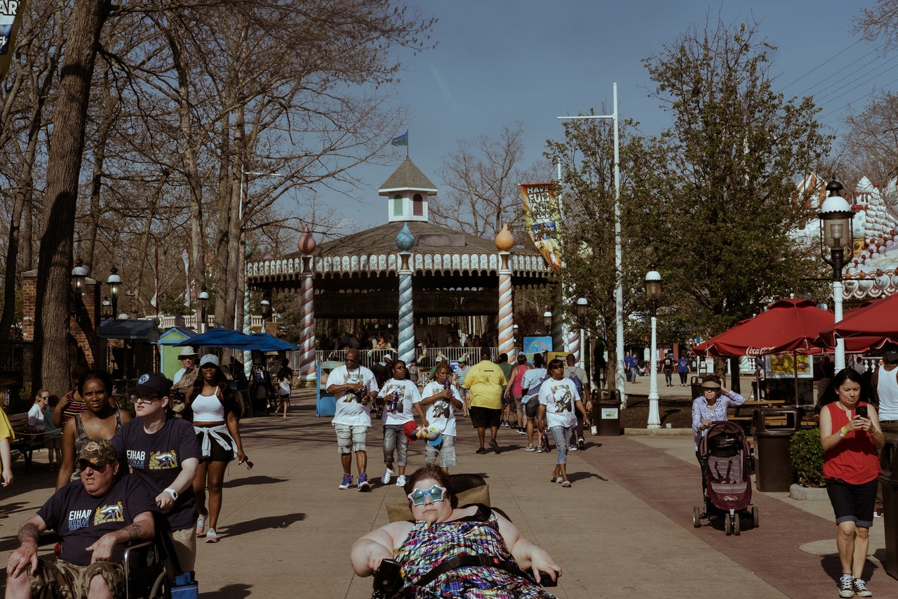 Families walk together down Main Street, a central hub to Six Flags that's located close to the entrance of the park.