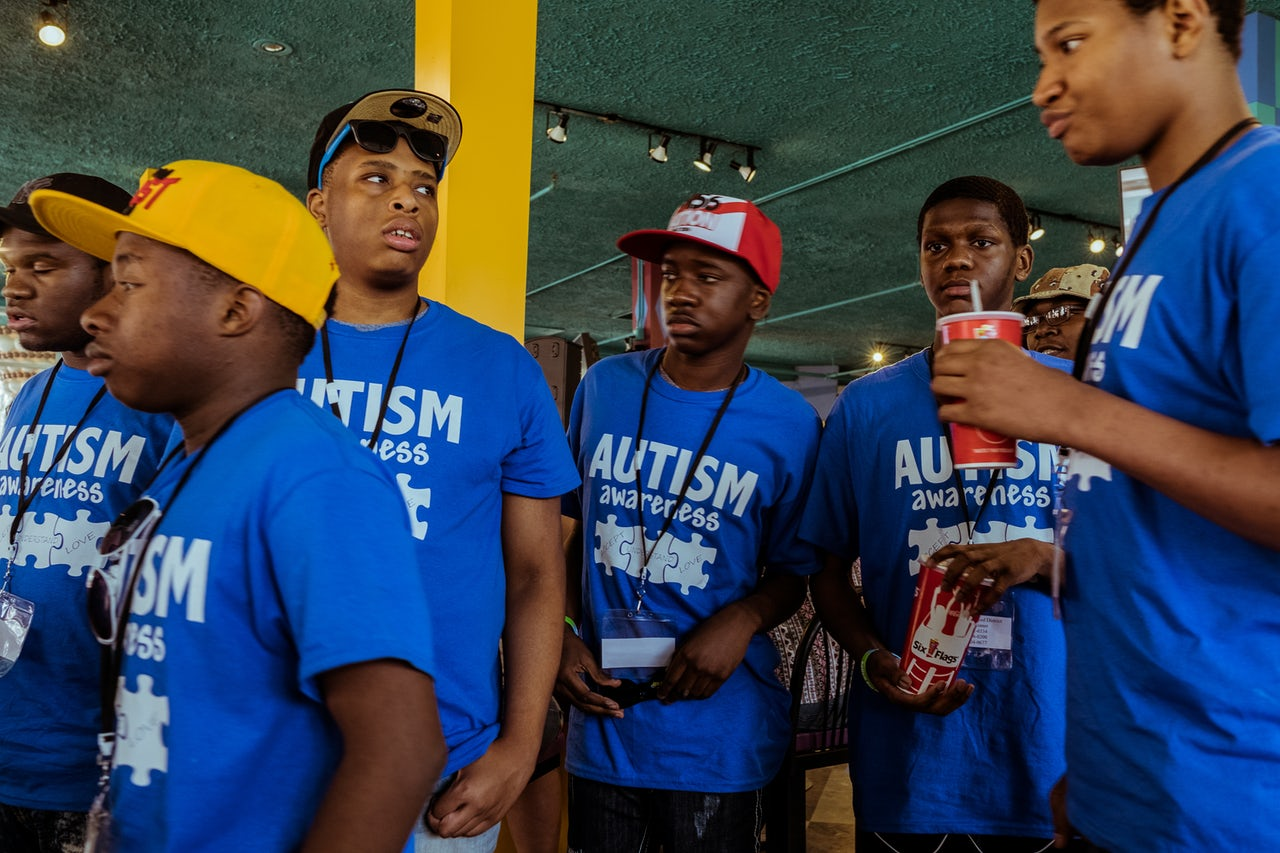 A group of young, teenage boys, who came to Autism Day together, walk through the Yum Yum Cafe.