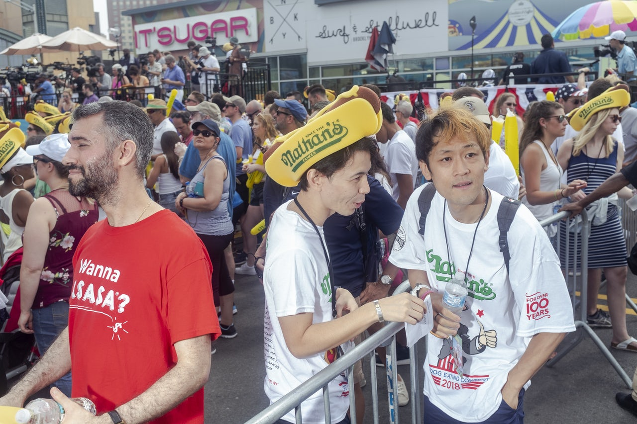 Max Suzuki speaks with his manager at the Nathan's contest.