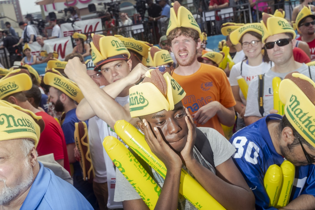 Sweaty fans in the Nathan's crowd.