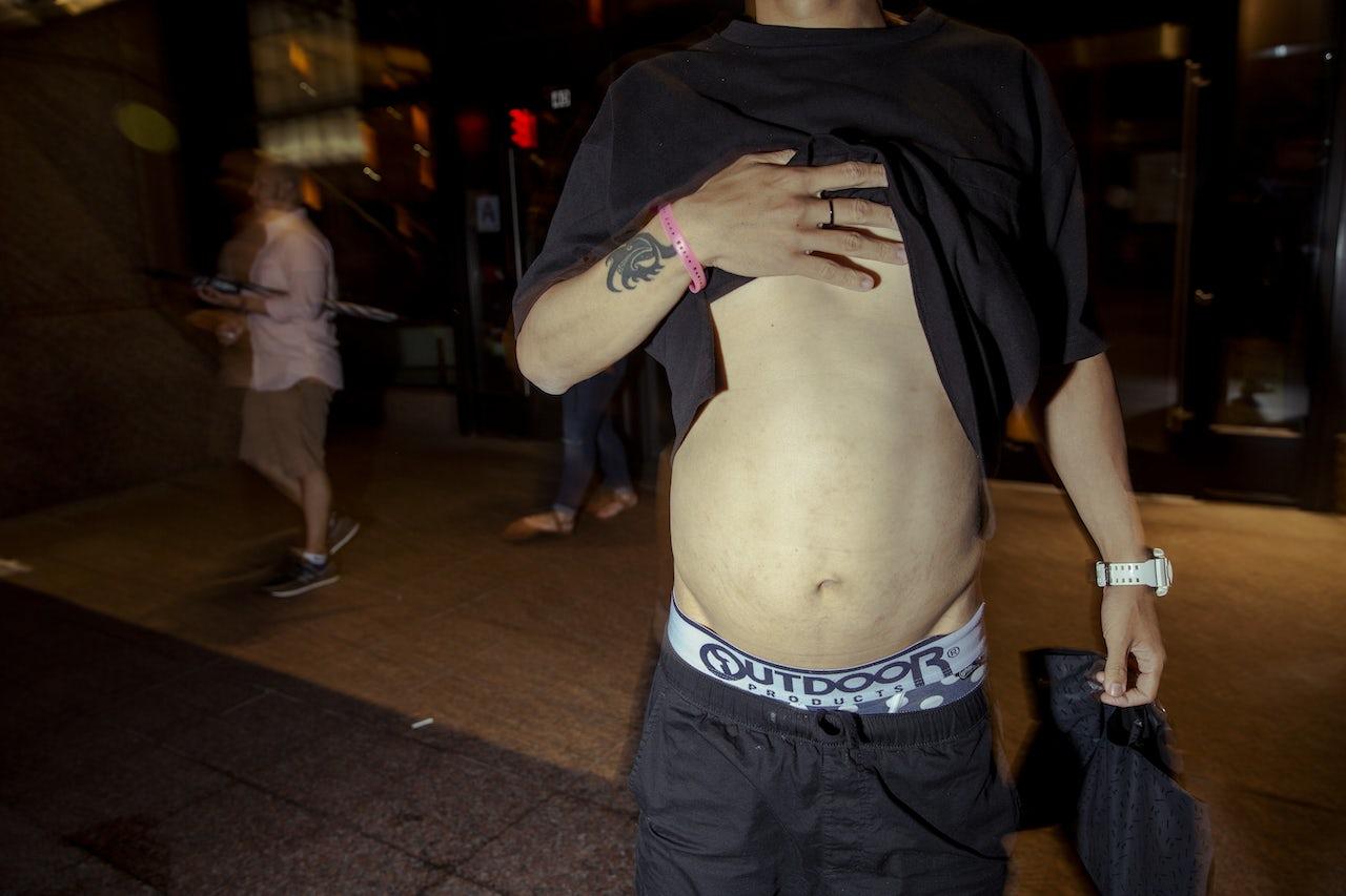 Max Suzuki shows off his stomach.