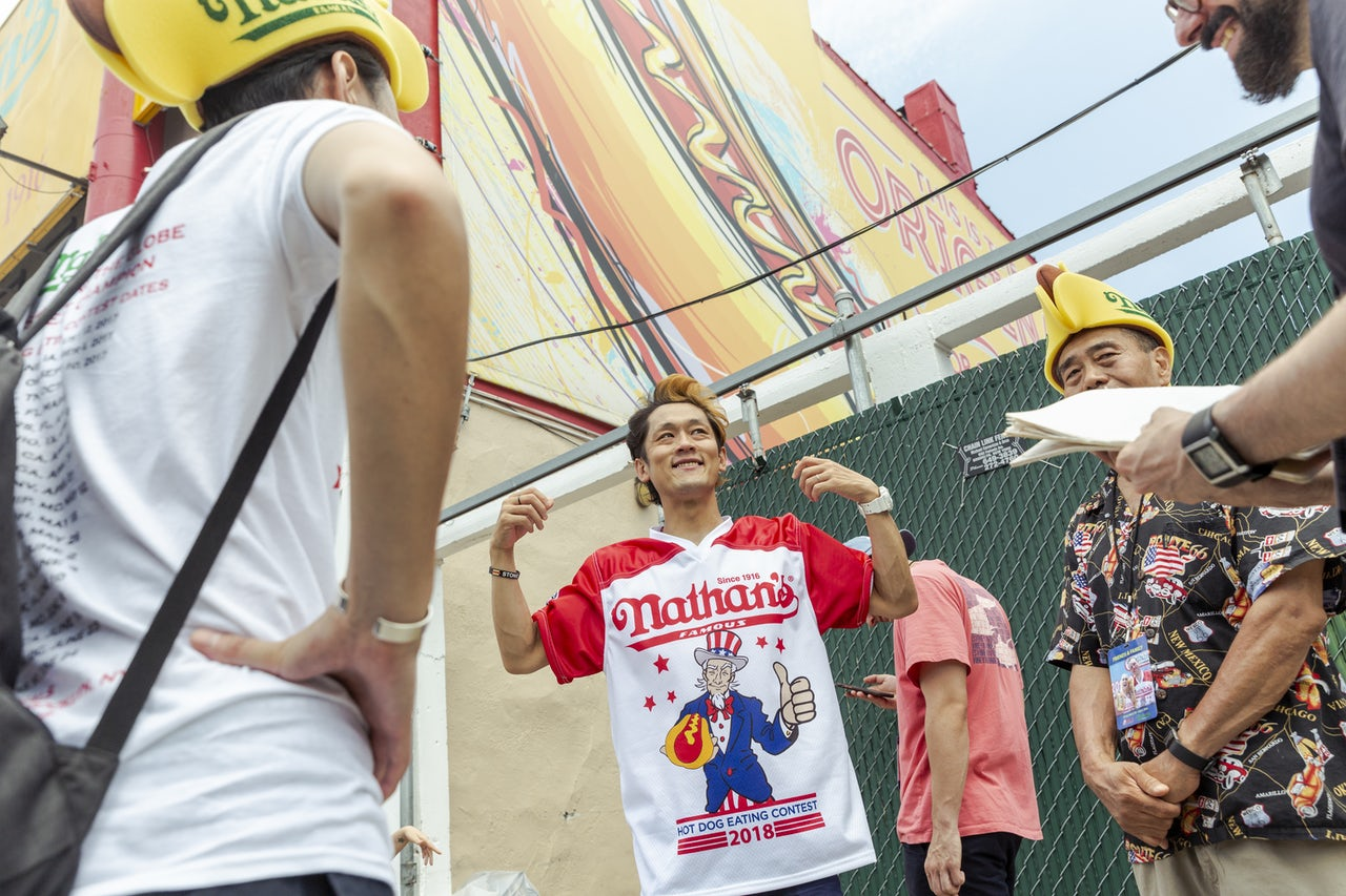 Max Suzuki signs autographs at the Nathan's hot dog eating contest.