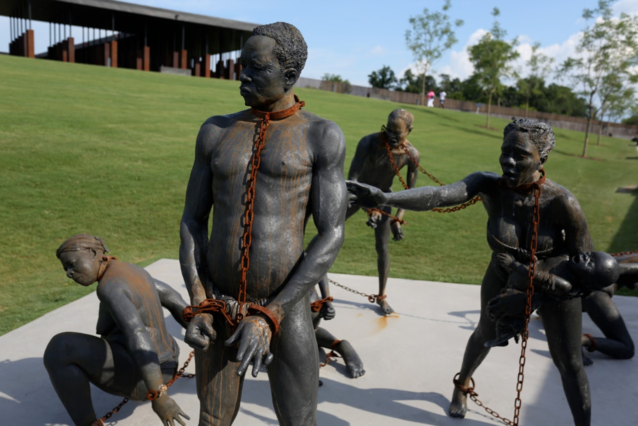 Statues of slaves outside the National Memorial for Peace and Justice.