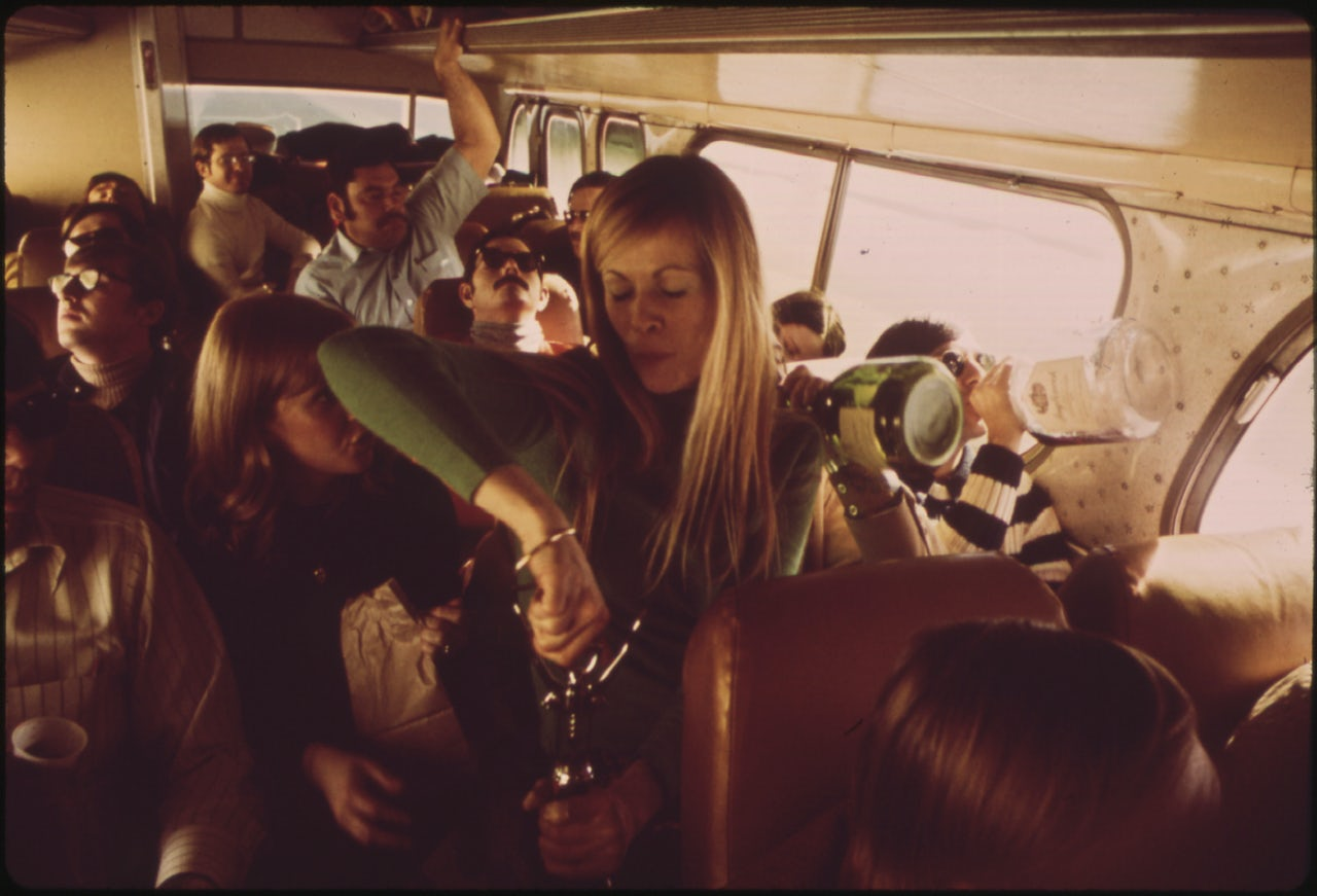 Young people drinking on a bus, circa 1974.