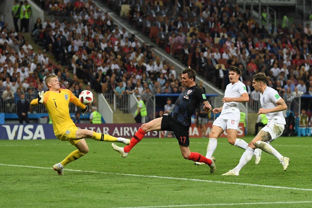 Croatia's Mario Mandžukić attempts to score on England.