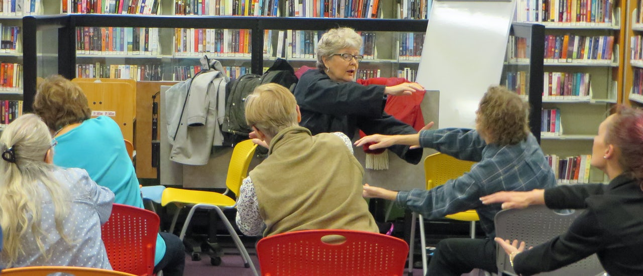 Seniors use newly open space in the Bellingham Public Library for a seated workout program.
