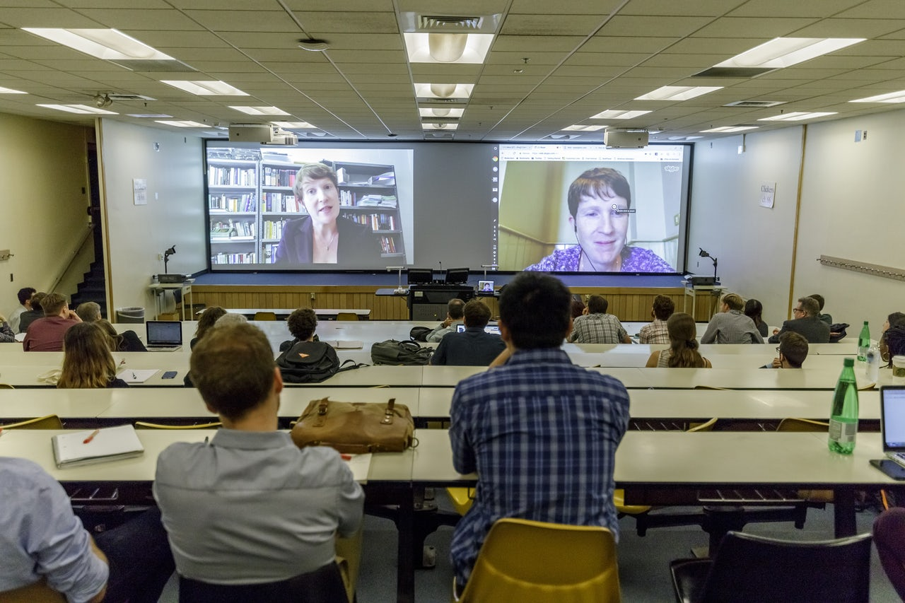Attendees watching Clare Hayes-Brady's keynote (left) and Hayes-Brady live via Skype (right)