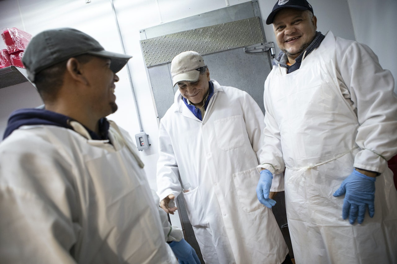Victor (center) and other Met Food butchers sharing a laugh.