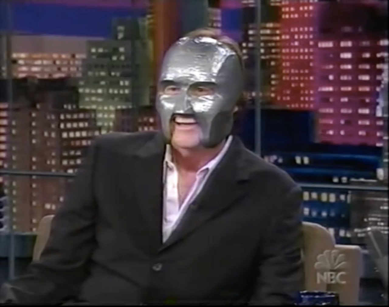 Jim Carrey wears a replica 'Mr. Personality' mask to begin his 2003 appearance on 'The Tonight Show.'