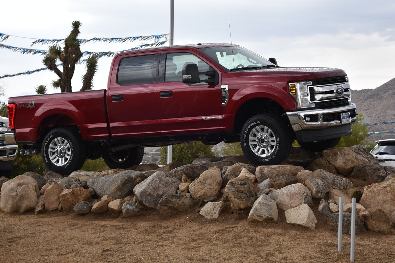 The Ford F-150, a car so macho that it has to sit on a big pile of rocks, is just one example of cars that make fake engine noise.