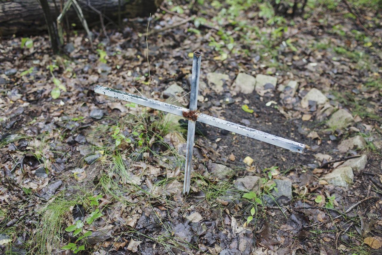 A cross marks the spot where Tom Crosslin was killed.