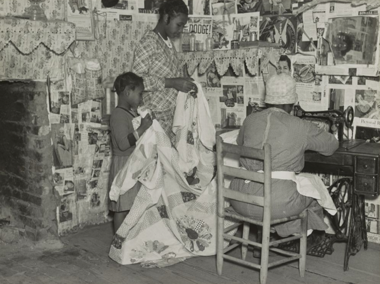 Lucy Mooney making a quilt with her granddaughters in 1937. She once worked as the cook on the Pettway plantation.