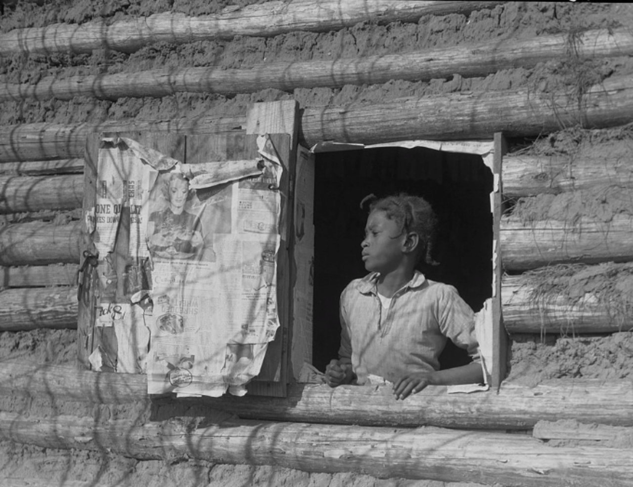 "Arthur Rothstein was the first photographer hired by the New Deal-funded Resettlement Agency to document rural life in America. ""Girl at Gee's Bend,"" taken when he visited the community in 1937, is among his most-famous images. It shows a young Artelia Bendolph in her family's log cabin. The federal official who commissioned Rothstein called Gee's Bend ""the most primitive set-up"" he'd ever heard of. Bendolph died in 2003 at age 76."