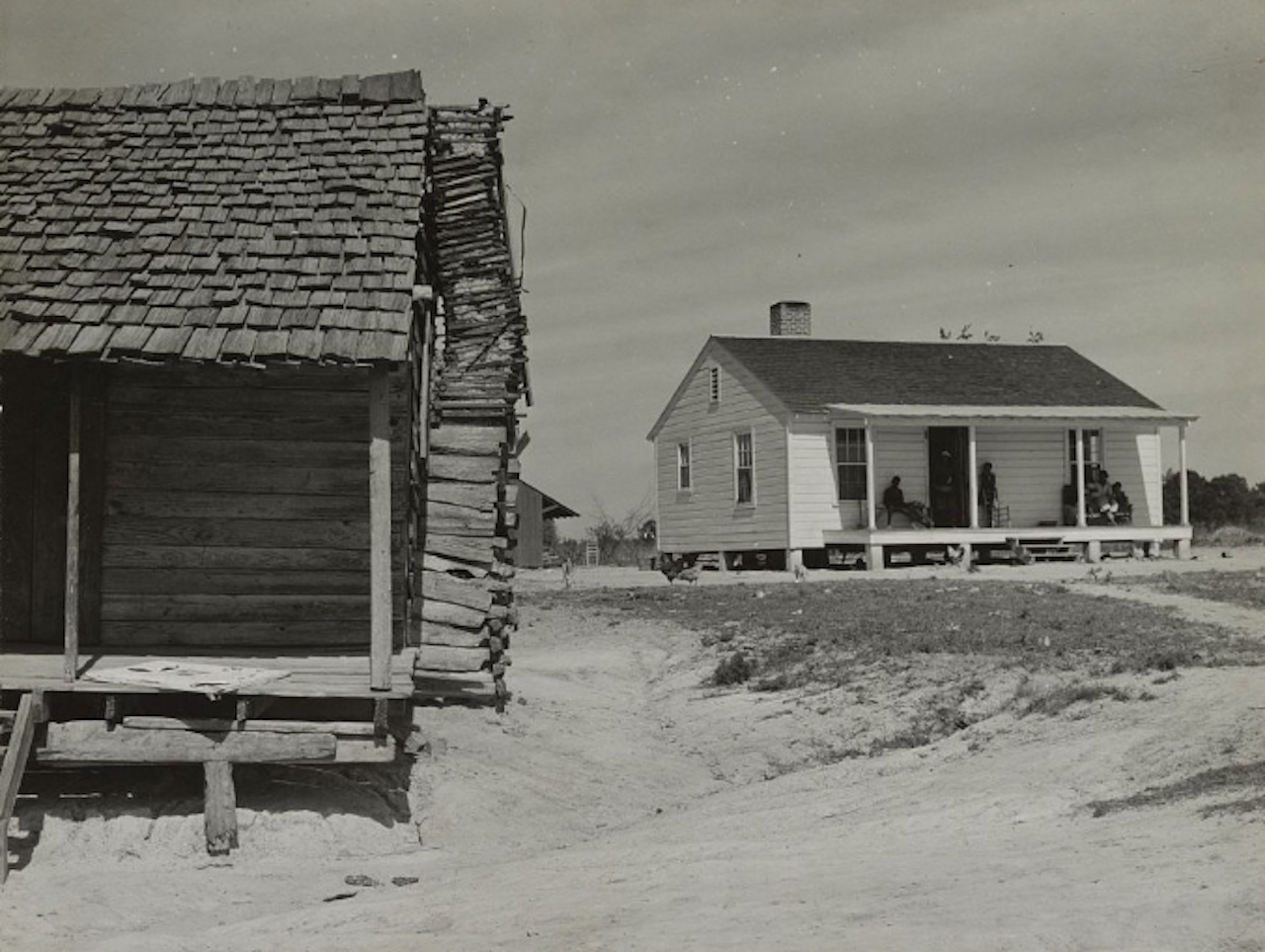 "The contrast between the cabin, at left, and the new ""Roosevelt House,"" at right, was documented in 1939, two years after the federally funded Resettlement Program began."