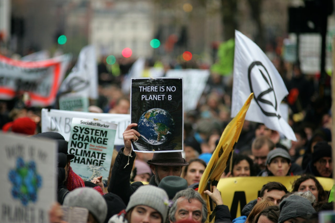 Protesters carried signs calling attention to the dire state of the climate.