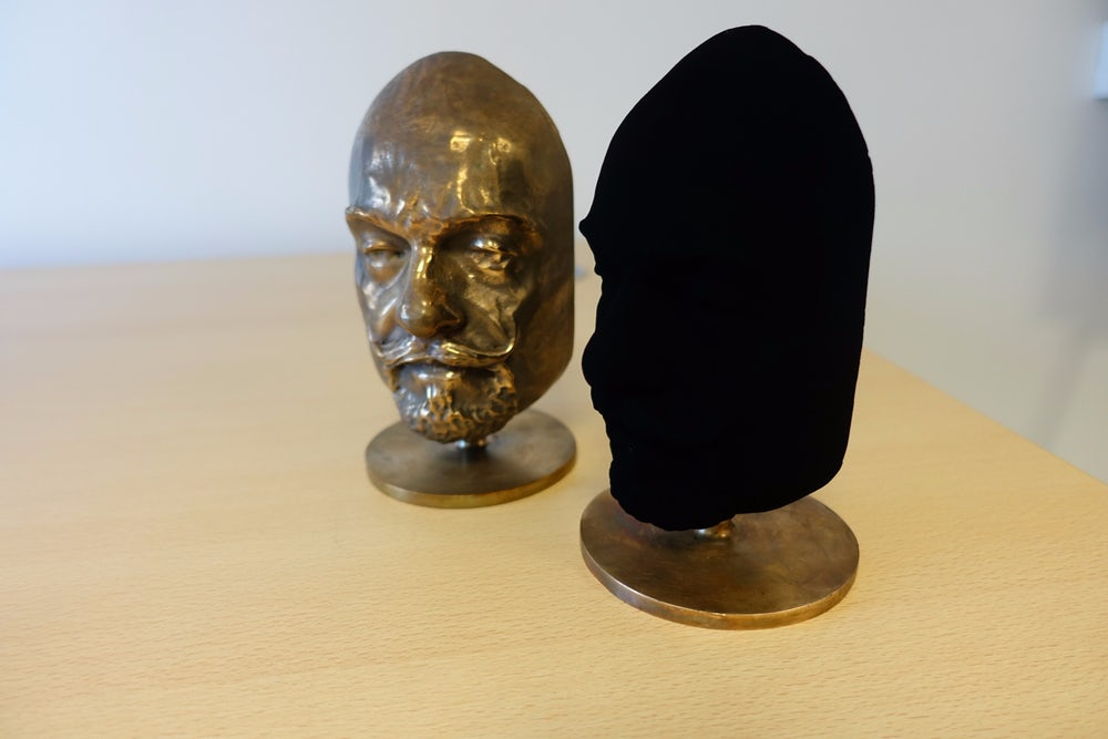 Two masks of BBC host Marty Jopson, one coated in Vantablack